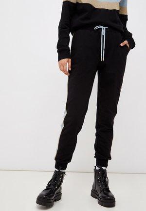 Pantalones deportivos - coloured denim