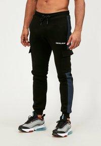 Kings Will Dream - Cargo trousers - black/navy - 0