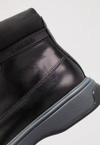 Calvin Klein - PHYFELACE UP BOOTIE - Nauhalliset nilkkurit - black - 5
