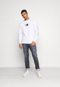 Tommy Jeans - SCANTON - Jeans Slim Fit - denim - 1