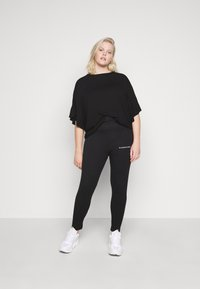 CAPSULE by Simply Be - BOXY RUFFLE SLEEVE  - Basic T-shirt - black - 1