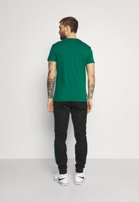 Lacoste Sport - TRACK PANT - Trainingsbroek - black/bottle green - 2