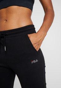 Fila - LAKIN - Spodnie treningowe - black - 3