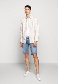 7 for all mankind - REGULAR HEMET - Denim shorts - light blue - 1