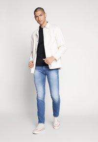 Diesel - THOMMER-X - Slim fit jeans - blue denim - 1