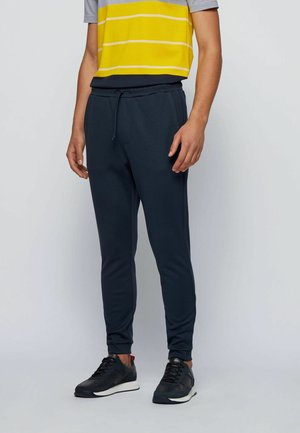 HADIKO - Tracksuit bottoms - dark blue