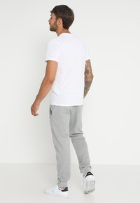 Jack & Jones - JCOFOAM TEE - Print T-shirt - white - 2