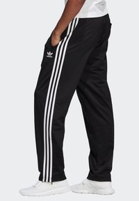 adidas Originals - FIREBIRD ADICOLOR TRACK PANTS - Tracksuit bottoms - black - 2