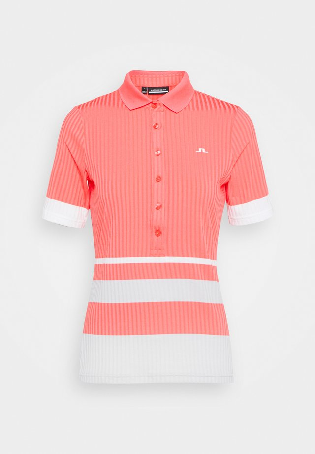 JUNE GOLF - Polo - tropical coral