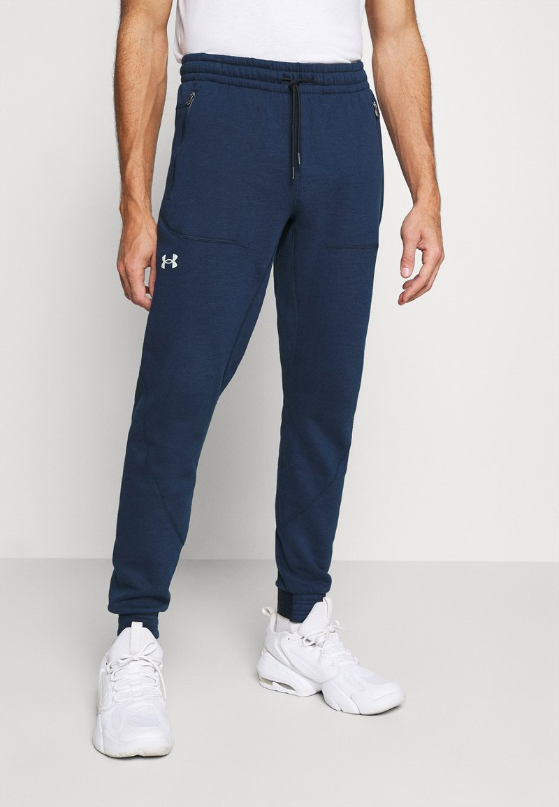 Under Armour - Tracksuit bottoms - academy/halo gray
