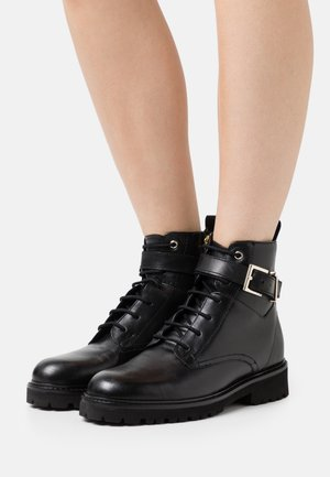 RAIGN - Lace-up ankle boots - black