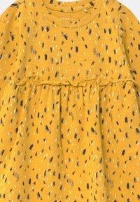 Name it - NBFNATASJA BABY - Jersey dress - spicy mustard - 2