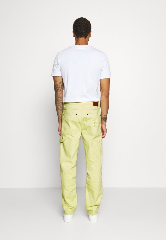 PANTS  - Jeansy Relaxed Fit - yellow