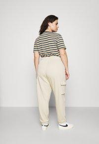 Nike Sportswear - Tracksuit bottoms - rattan/white - 2