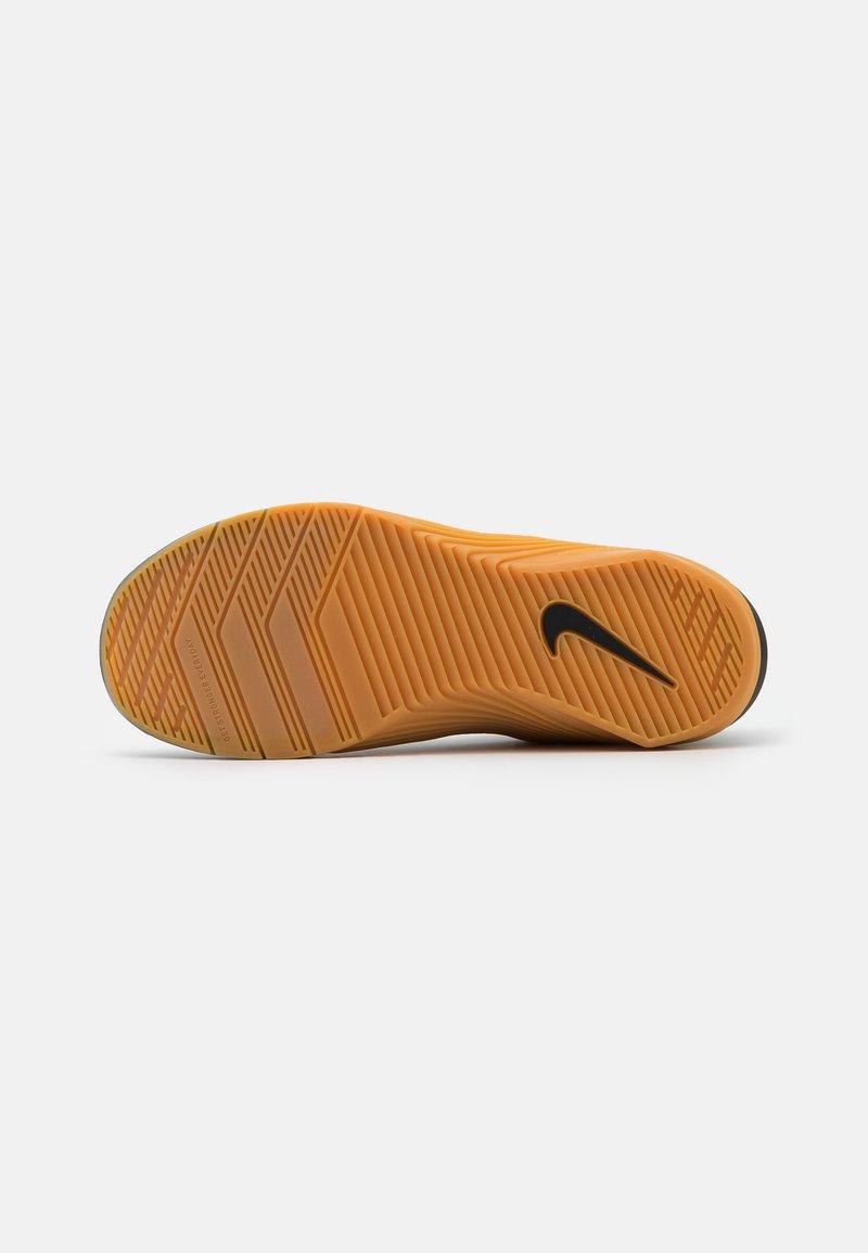 Vientre taiko Romper Desgastar  Nike Performance METCON 6 UNISEX - Zapatillas de entrenamiento -  black/limelight/medium brown/negro - Zalando.es