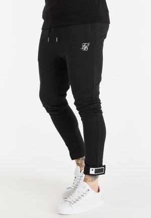 ACTIVE TAPE CUFF PANTS - Tracksuit bottoms - black