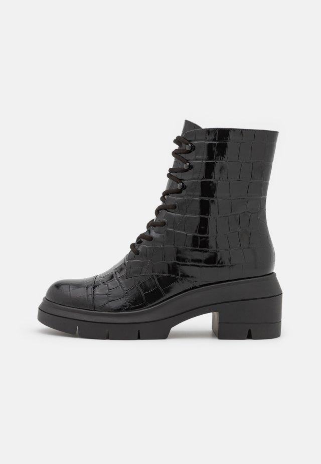 NISHA - Platform ankle boots - black