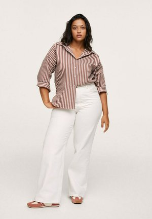 NORA - Flared Jeans - gebroken wit