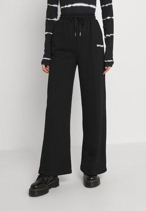 BASIC WIDE LEG PANTS - Tracksuit bottoms - black