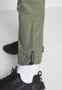 Nike Sportswear - Tracksuit bottoms - twilight marsh/white - 3