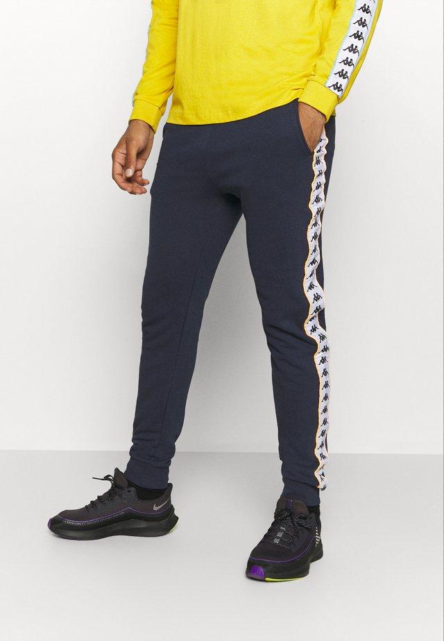 HENNER PANT - Pantalon de survêtement - total eclipse