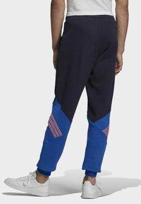 adidas Originals - SPRT ARCHIVE MIXED MATERIAL JOGGINGHOSE - Träningsbyxor - blue - 1