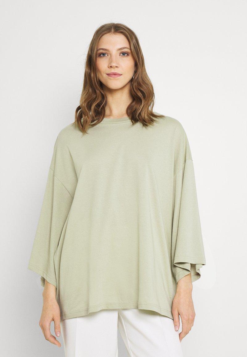 Monki - BILLA TEE - Basic T-shirt - green dusty light