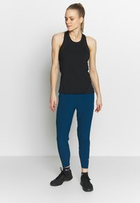 Nike Performance - Pantalones - valerian blue/reflective silver - 1