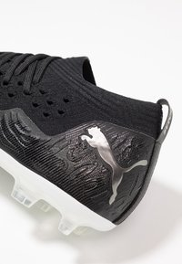 Puma - FUTURE 19.2 NETFIT FG/AG - Moulded stud football boots - black/white - 5
