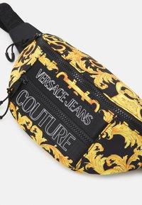Versace Jeans Couture - UNISEX - Bum bag - black/gold - 5