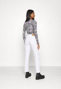 Levi's® - 724 HIGH RISE STRAIGHT - Straight leg jeans - western white - 2