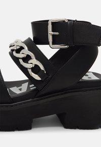 Buffalo - VEGAN ROCKET - Platform sandals - black - 5