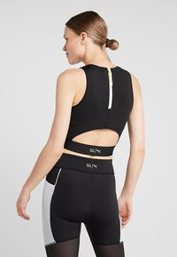 Puma - CROP - Top - black - 2