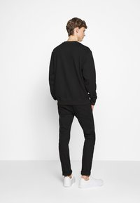 Versace Jeans Couture - CREW LABEL LOGO - Mikina - black - 1