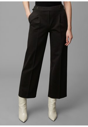 PURE HOSE - Trousers - black