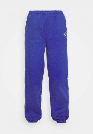 LOGOCOLLAGEPANTS - Tracksuit bottoms - blue