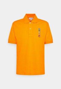 POLAROID UNISEX - Polo shirt - orpiment