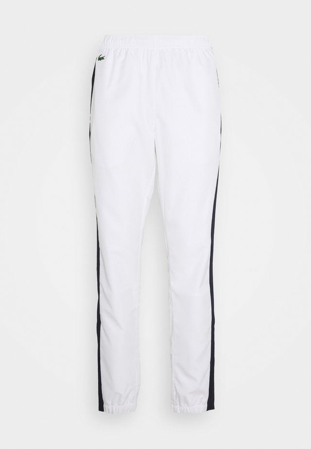 TENNIS PANT - Pantalon de survêtement - white/navy blue