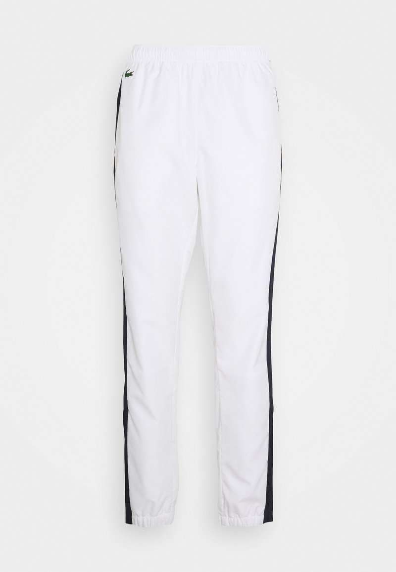 Lacoste Sport - TENNIS PANT - Tracksuit bottoms - white/navy blue