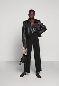 By Malene Birger - MIELA - Trousers - black - 1