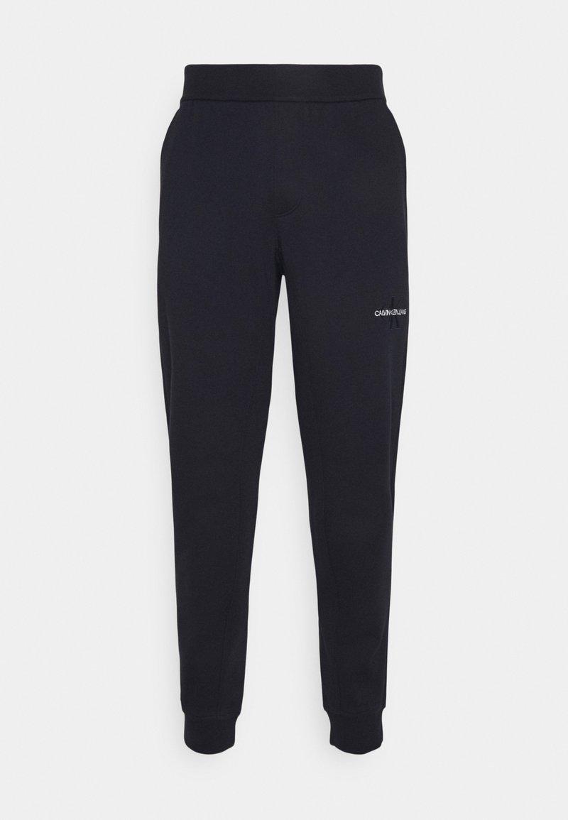 Calvin Klein Jeans - OFF PLACED ICONIC PANT - Verryttelyhousut - blue