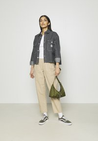 Vero Moda - VMEVANY LOOSE STRING ANKLE PANTS - Trousers - beige - 1