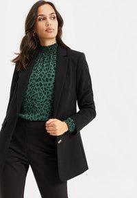 WE Fashion - Short coat - black - 0