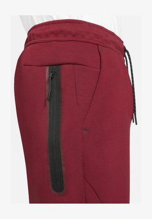 M NSW TCH FLC JGGR - Tracksuit bottoms - team red/university red