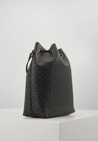 Calvin Klein - DRAWSTRING BUCKET BAG MONOGRAM - Sac bandoulière - black - 3