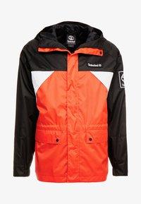 OUTDOOR ARCHIVEHOODED  - Windbreaker - white/spicy orange/black