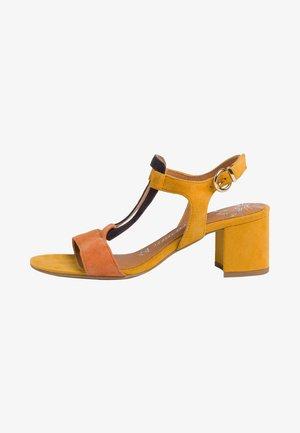 Sandaalit nilkkaremmillä - saffron