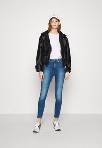 Calvin Klein Jeans - HIGH RISE SUPER SKINNY ANKLE - Jeans Skinny Fit - bright blue - 1