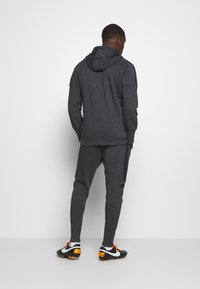 Under Armour - ACCELERATE OFF-PITCH JOGGER - Träningsbyxor - black - 2