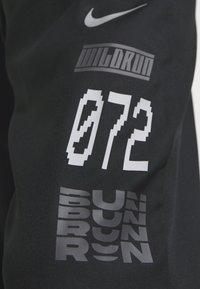 Nike Performance - PANT - Tracksuit bottoms - black/silver - 4